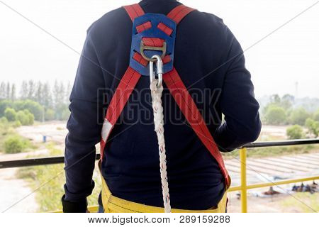 Close-up Worker In Safety Harness On High Construction Site . Concept For Occupational Health Safety
