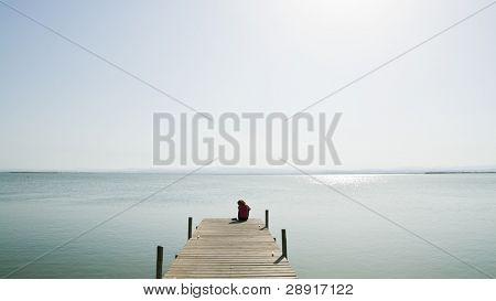 Lone woman in the lake.