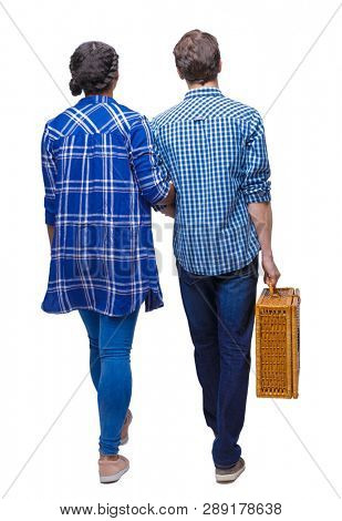 Back view of interracial going couple with a picnic bag. walking friendly girl and guy holding hands. Rear view people collection.  Isolated over white background. A young couple goes on a picnic. poster