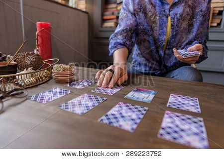 Close Up Of Tarot Cards Lying On The Table
