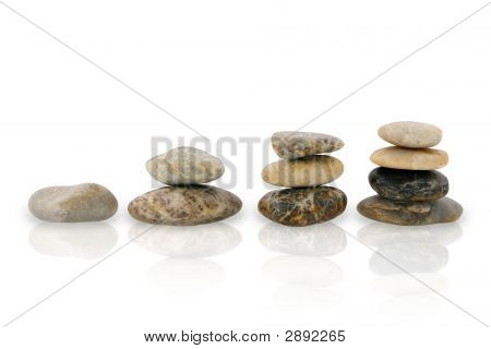 Four Piles Of Pebbles