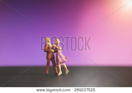 Miniature People , Couple Dancing With Colorful Bokeh  Background