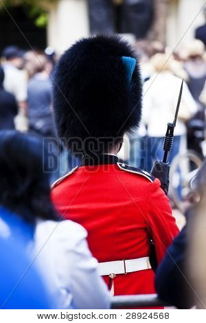Queen guard surrounded by the crowd