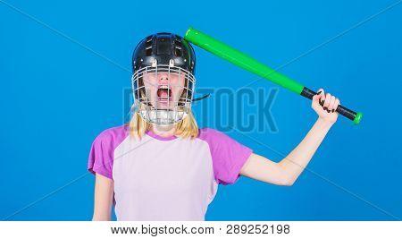 Woman Having Fun During Baseball Game. Girl Pretty Blonde Wear Baseball Helmet And Hold Bat On Blue