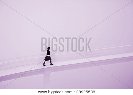 Young woman going uphill on an empty space