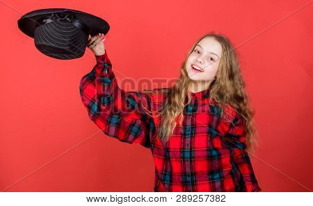 Girl Artistic Kid Practicing Acting Skills With Black Hat. Acting School For Children. Acting Lesson