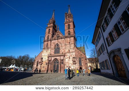 Basel, Switzerland - March 10, 2019: Basel Minster With People In Front Of It. The Basel Minster Is
