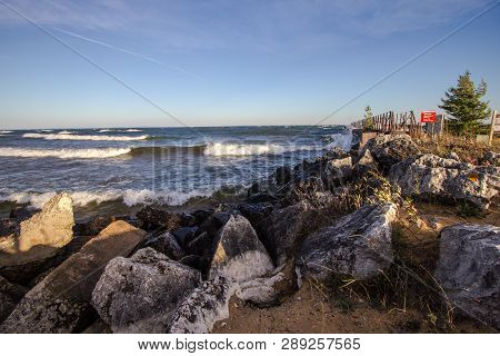 Scenic Rocky Coast. Waves Crash On The Rocky Coast Of Lake Superior On A Sunny Summer Afternoon In M