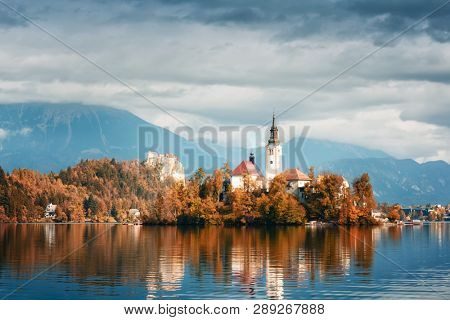 Amazing autumn view of Bled lake in Julian Alps, Slovenia. Pilgrimage church of the Assumption of Maria on a foreground. Landscape photography