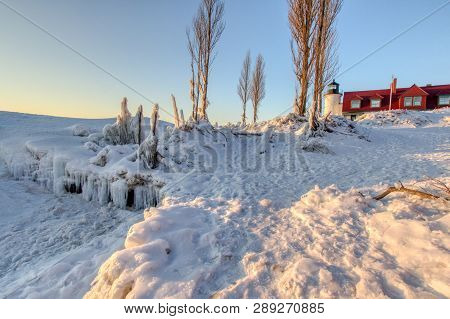 Winter Lighthouse Landscape. Beautiful Point Betsie Lighthouse Surrounded By Ice And Snow On A Cold