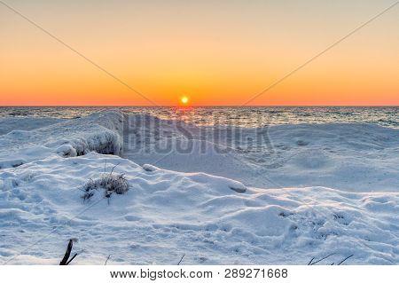 Winter Lake Sunset Landscape. Sunset Horizon Over A Snowy Lake Michigan Coast At Sleeping Bear Dunes