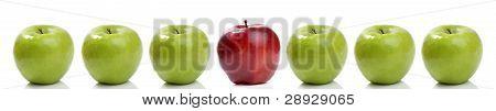 red apple between green apples