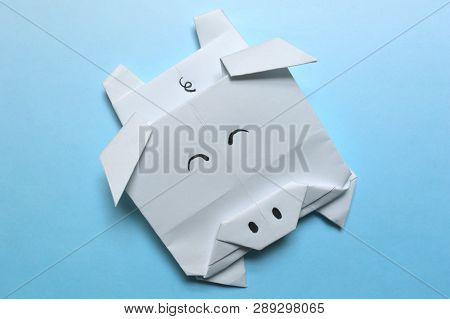 White Origami Pig, Paper Folding, On Blue Background