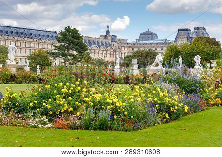 Sculptures And Flower Beds In The Public Garden Of Tuileries. Paris. France.