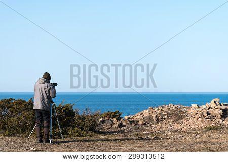 Male Bird Watcher By The Coast Of The Swedish Island Oland