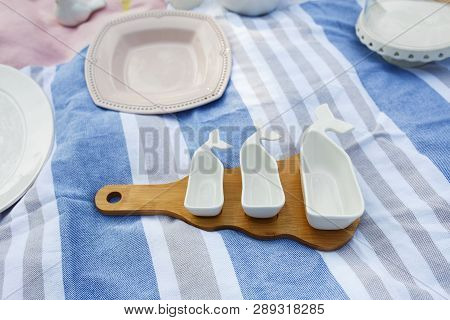 Set Of White Empty Sauceboats On A Wooden Tray Serves A Picnic.