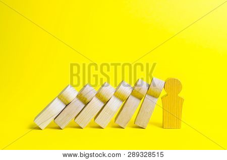 Gold figure leader prevents fthe fall of a set of figures like dominoes. Colaps dominoes. Strong leader and reliable support and loyal. business training, self-improvement, stress resistance poster