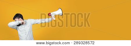 Man In Dub Dance Pose With A Megaphone In His Hand Turns Him Away, Concept Of Reluctance To Protest,