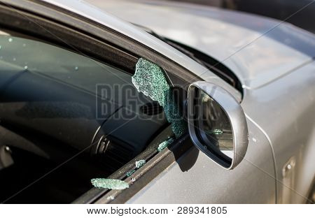 Car Window Smashed By A Thief. Car Broken Window. Broken Right Side Window Of A Car Parked On The St