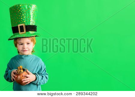 St. Patrick's Day Celebrations. Traditions Of Saint Patrick Day. Cute Boy Holds Pot Of Gold. Little