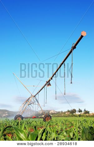 Modern irrigation pivot system watering a farm land