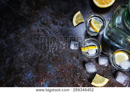 Tequila Vodka Shots And Bottle With Lemon Slices, Top View