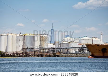 Industrial Zone With New York Skyscraper In Distance, Usa.