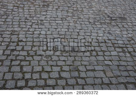 Gray Stone Texture Of Old Square Paving Tiles On The Road