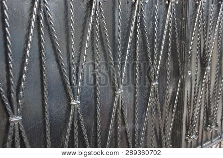 Gray Black Metal Background From Iron Rods In Forged Pattern