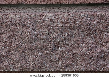 Brown Stone Texture Of A Piece Of Granite In The Wall