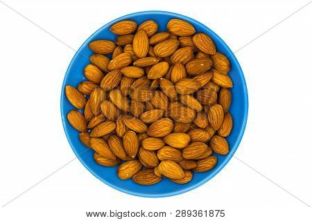 Almond Nuts In Blue Plate On White Background. Almond Nut Flat Lay. Almond Heap Top View. Tasty Heal