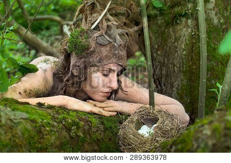 Dryad Guarding A Bird's Nest In The Woods
