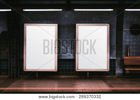 Two Empty Ad Vertical Posters Templates On A Metro Platform; Blank Information Banners Placeholders