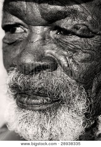 Close up macro photo of a old African man with a very caracterful face
