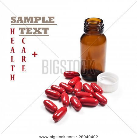 Red pills around a pill bottle on a white background with space for text