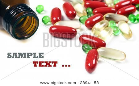 Pill bottle with red and green pills - on a white background with space for text