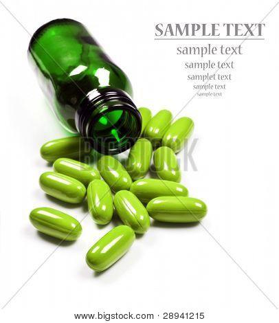 Pills spilled around a pill bottle