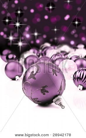 Soft purple christmas ornaments with star background