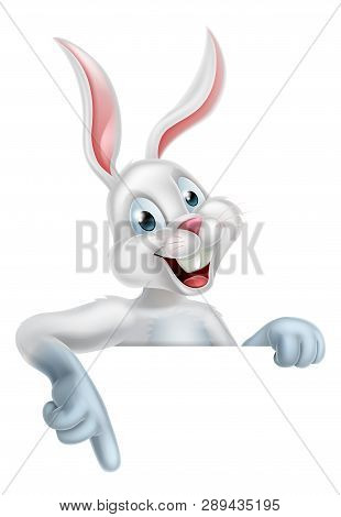 A Happy Cartoon White Bunny Rabbit Pointing Down, Could Be The Easter Bunny