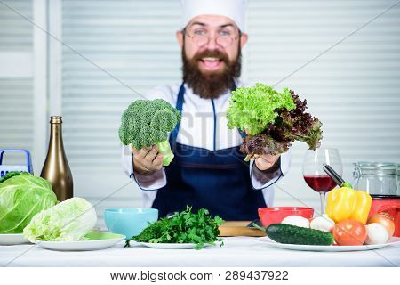 Healthy Vegetarian Recipe. I Choose Only Healthy Ingredients. Man Cook Hat And Apron Hold Broccoli.