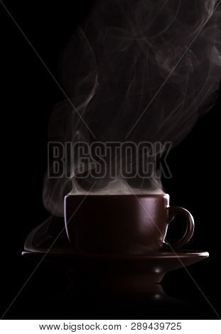 Cup Of Fragrant Hot Coffee With Steam Isolated On Black Background