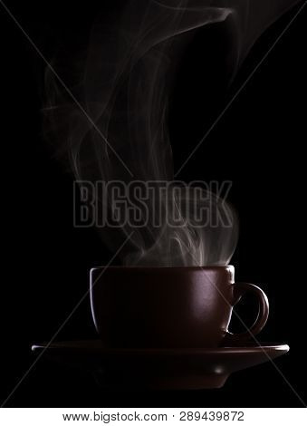 Silhouette Coffee Cups With Saucer And Hot Steam Isolated On Black Background