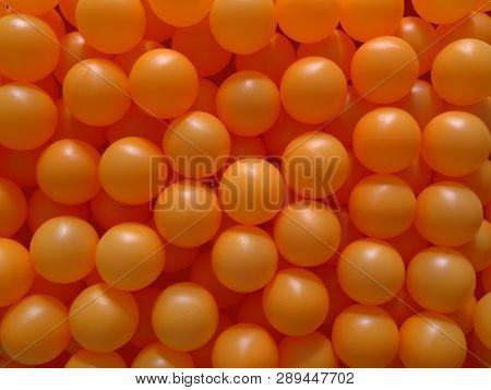 Background Of Orange Ping Pong Balls, Close Up