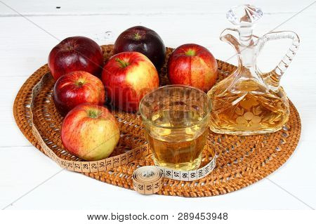Apple Vinegar And Apples. Fresh Apples, Apple Vinegar, Measuring Tape, A Bottle And Glass On White W
