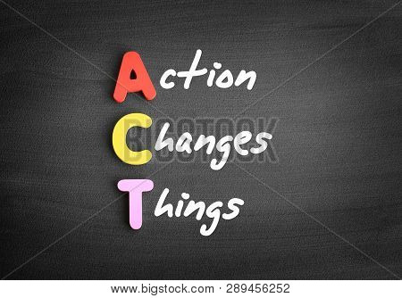 Color Wooden Alphabets Building The Word Act - Action Changes Things Acronym On Blackboard