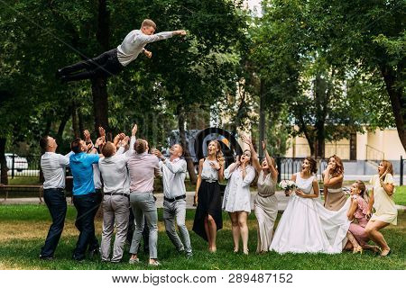 Russia, Orenburg -july 21, 2018: Newlyweds And Guests Having Fun At The Wedding. Bride, Groom And Gu