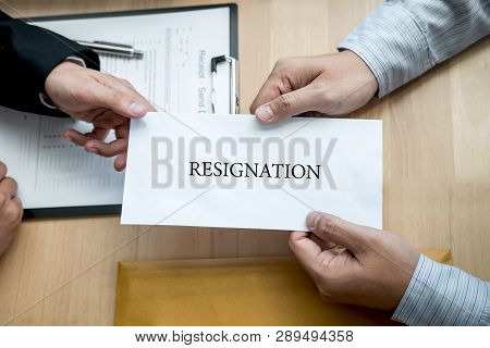 Businessman sending a resignation letter to employer boss in order to resign dismiss contract, changing and resigning from work concept. poster