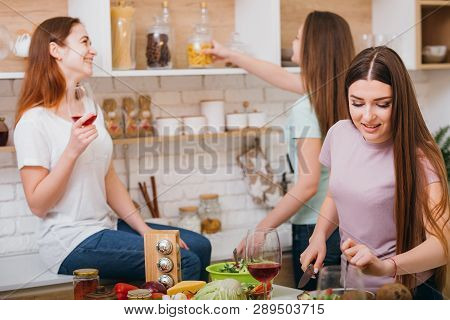 Girls Kitchen Party. Friends Communication. Fun Leisure. Women Drinking Wine And Talking While Cooki