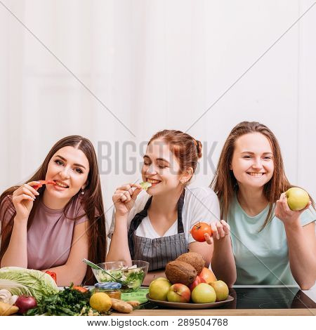 Healthy Nutrition And Diet Food. Vegetarian Cooking And Weightloss. Young Women Snacking On Veggies