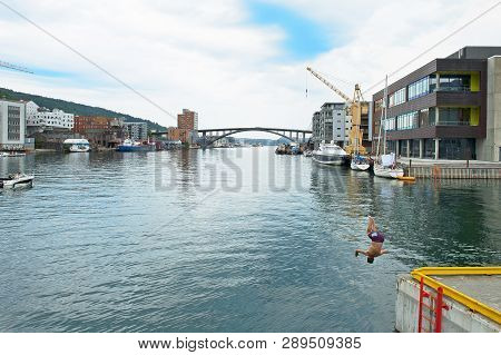 Bergen, Norway - July 17, 2018: Puddefjord Bridge - Puddefjordsbroen And Man Jumping Into The Water